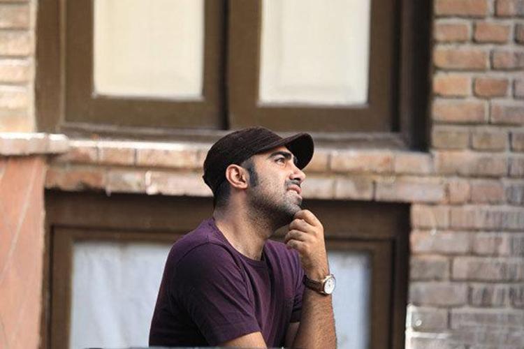 (عکس) روایت محمد تنابنده نویسنده نون خ از مقایسه شدن با برادرش
