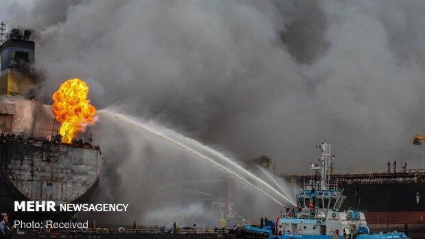 آتش سوزی یک نفتکش بر اثر برخورد با کشتی باری در آبهای ساحلی چین